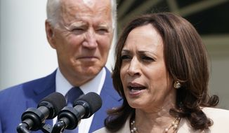 President Joe Biden, left, listens as Vice President Kamala Harris, right, speaks during an event in the Rose Garden of the White House in Washington, Monday, July 26, 2021, to highlight the bipartisan roots of the Americans with Disabilities Act and marking the law's 31st anniversary. (AP Photo/Susan Walsh)