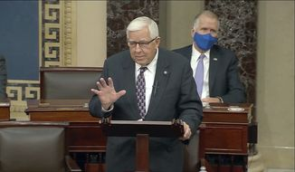 In this Dec. 2, 2020, file photo taken from U.S. Senate video, Wyoming's low-key senior U.S. Sen. Mike Enzi says goodbye to colleagues, in Washington. Enzi, who was hospitalized Monday, July 26, 2021, with a broken neck and ribs three days after a bicycle accident outside his hometown, has died at age 77. (U.S. Senate via AP, file)
