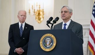 In this June 23, 2021, photo, President Joe Biden listens as Attorney General Merrick Garland speaks during an event in the State Dining room of the White House in Washington to discuss gun crime prevention strategy. (AP Photo/Susan Walsh) **FILE**