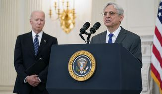 In this June 23, 2021 file photo, President Joe Biden listens as Attorney General Merrick Garland speaks during an event in the State Dining room of the White House in Washington to discuss gun crime prevention strategy. (AP Photo/Susan Walsh) ** FILE **
