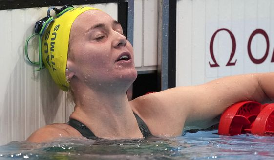 Ariarne Titmus of Australia rests after winning the final of the women's 400-meters freestyle at the 2020 Summer Olympics, Monday, July 26, 2021, in Tokyo, Japan. (AP Photo/Matthias Schrader)