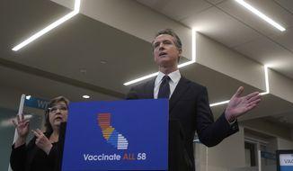 Gov. Gavin Newsom speaks at a news conference in Oakland, Calif., Monday, July 26, 2021. (AP Photo/Jeff Chiu)