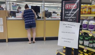 A sign at a pharmacy in a grocery store in Cape May Court House, New Jersey, on Sunday, July 18, 2021, informs customers the Pfizer COVID-19 vaccine is in stock and walk-in coronavirus vaccinations are available. (AP Photo/Ted Shaffrey)