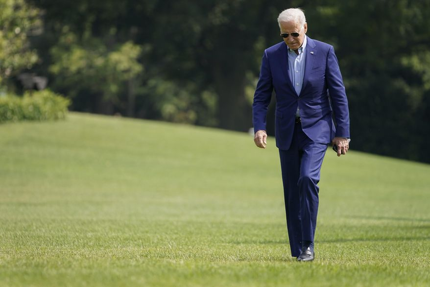President Joe Biden walks on the South Lawn of the White House after stepping off Marine One, Sunday, July 25, 2021, in Washington. Biden is returning to Washington after spending the weekend in Delaware. (AP Photo/Pablo Martinez Monsivais)