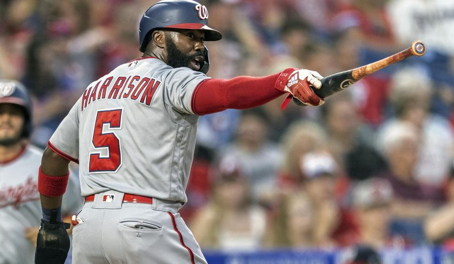 Washington Nationals' Josh Harrison (5) gestures at home plate with Gerardo Parra's bat after he scored on an RBI-single by Parra during the fourth inning of a baseball game against the Philadelphia Phillies, Monday, July 26, 2021, in Philadelphia. (AP Photo/Laurence Kesterson)
