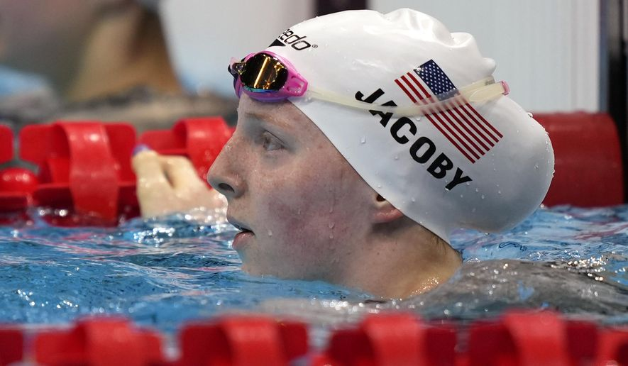 Lydia Jacoby of the United States rests after her semifinal in the women's 100-meter breaststroke at the 2020 Summer Olympics, Monday, July 26, 2021, in Tokyo, Japan. (AP Photo/Martin Meissner)