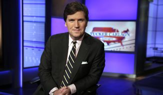 """In this Thursday, March 2, 2017, photo, Tucker Carlson, host of """"Tucker Carlson Tonight,"""" poses for a photo in a Fox News Channel studio in New York. (AP Photo/Richard Drew) **FILE**"""