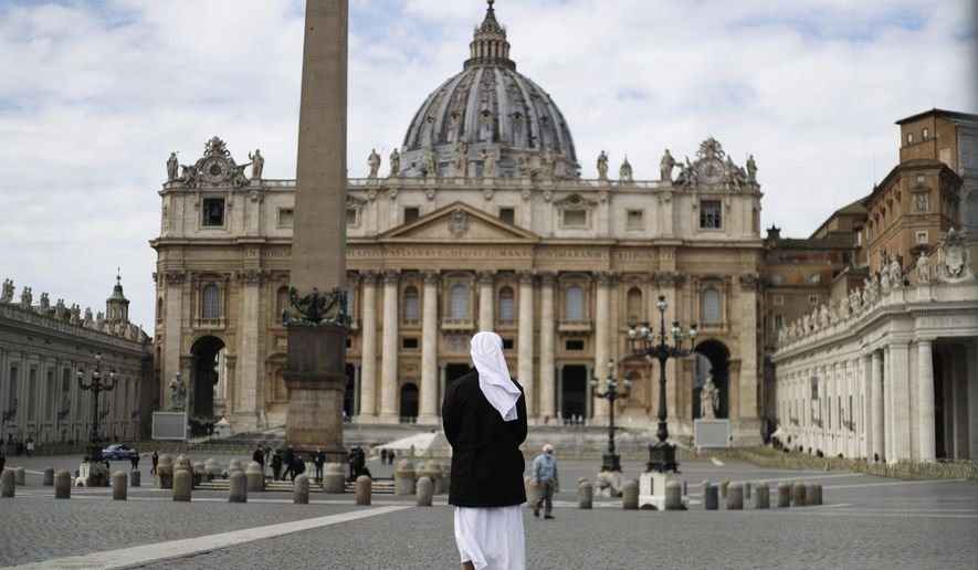 In this Sunday, March 21, 2021, file photo, a nun stands in St. Peter's Square at the Vatican. (AP Photo/Gregorio Borgia, File)