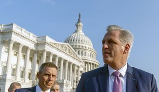House Minority Leader Kevin McCarthy of Calif., accompanied by Rep. Kelly Armstrong, R-N.D., left, and other Republican House members, walk out to hold a news conference as the select committee on the Jan. 6 attack appointed by House Speaker Nancy Pelosi will begin to hold its first hearing, on Capitol Hill in Washington, Tuesday, July 27, 2021. (AP Photo/Andrew Harnik)