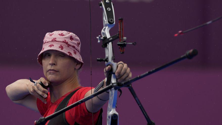 Canada's Stephanie Barrett shoots an arrow during the individual eliminations at the 2020 Summer Olympics, Tuesday, July 27, 2021, in Tokyo, Japan. (AP Photo/Alessandra Tarantino)