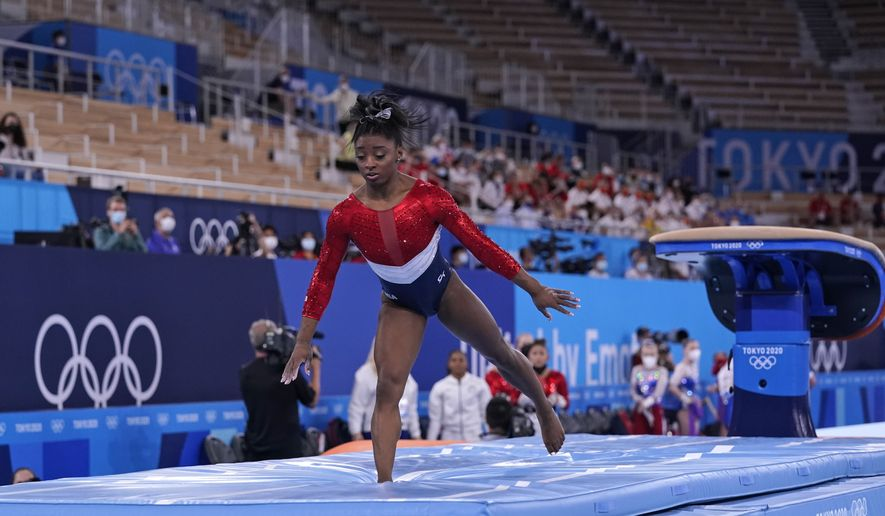 Simone Biles, of the United States, dismounts from the vault during the artistic gymnastics women's final at the 2020 Summer Olympics, Tuesday, July 27, 2021, in Tokyo. (AP Photo/Gregory Bull)