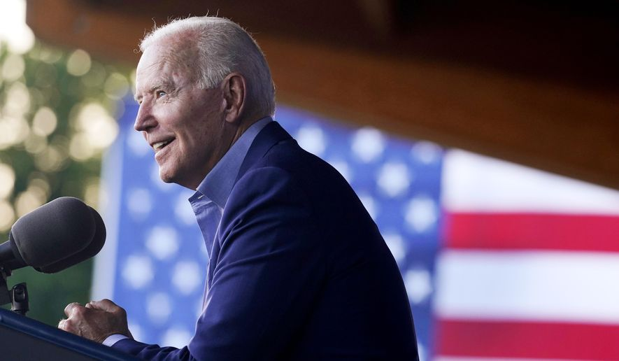 In this July 23, 2021, file photo, President Joe Biden speaks at a campaign event for Virginia Democratic gubernatorial candidate Terry McAuliffe at Lubber Run Park in Arlington, Va. (AP Photo/Andrew Harnik)