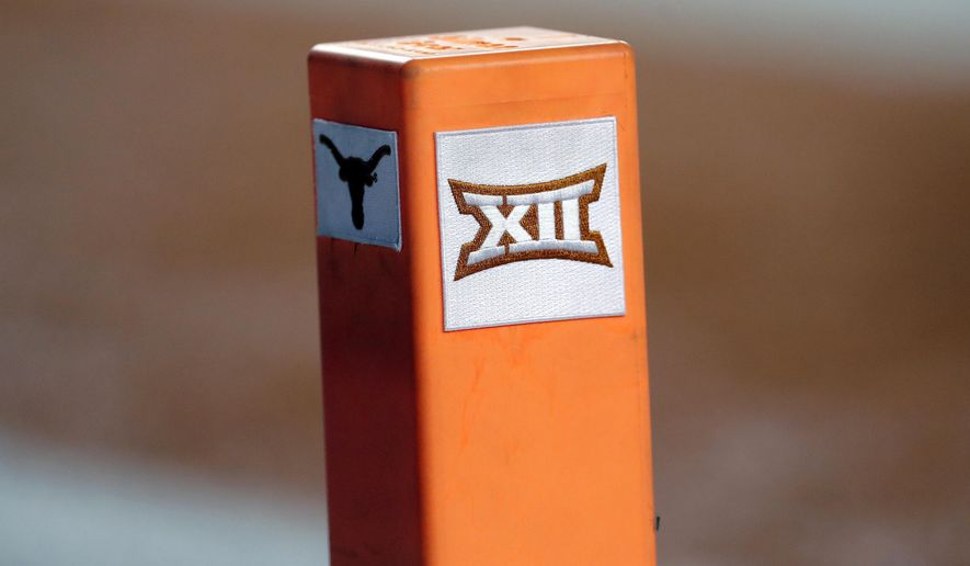 """In this Sept. 15, 2018, file photo, the Big 12 conference logo is seen on a pylon during the first half of an NCAA college football game between Texas and USC in Austin, Texas. Texas and Oklahoma made a request Tuesday, July 27, 2021, to join the Southeastern Conference — in 2025 —- with SEC Commissioner Greg Sankey saying the league would consider it in the """"near future."""" (AP Photo/Eric Gay, File) **FILE**"""