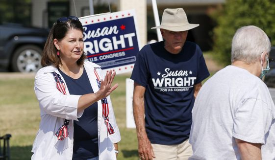 Susan Wright, Republican candidate for Texas' 6th Congressional District, greets voters outside a polling location during early voting for a special runoff election on Thursday, July 22, 2021, in Arlington, Texas. The runoff for a U.S. House seat in Texas is deciding who will fill the remaining term of Rep. Ron Wright, who died in February after contracting COVID-19. Voters on Tuesday, July 27 were choosing between Wright, the widow of the late congressman, and Jake Ellzey, a Republican state legislator. Wright is a longtime GOP party activist and carries the endorsement of former President Donald Trump. (Elias Valverde II/The Dallas Morning News via AP) **FILE**