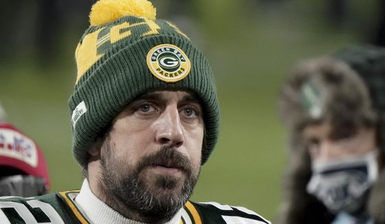 FILE - In this Sunday, Jan. 24, 2021, file photo, Green Bay Packers quarterback Aaron Rodgers (12) walks off the field after the NFC championship NFL football game against the Tampa Bay Buccaneers in Green Bay, Wis.  In a news conference, Monday, July 5, 2021, reigning NFL MVP Rodgers said he has spent this offseason focusing on improving himself in every respect, and that goes beyond making sure he's in top physical shape. (AP Photo/Morry Gash, File)