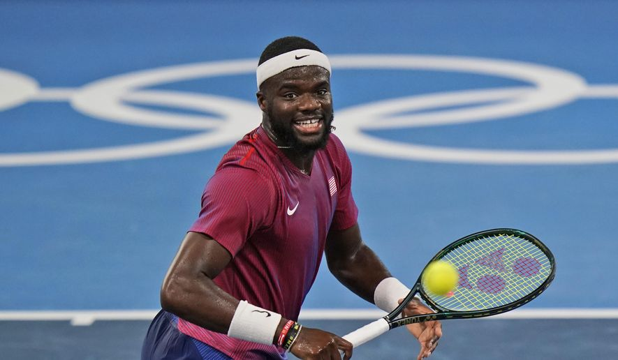 Frances Tiafoe, of the United States, plays Stefanos Tsitsipas, of Greece, during the second round of the tennis competition at the 2020 Summer Olympics, Tuesday, July 27, 2021, in Tokyo, Japan. (AP Photo/Seth Wenig) **FILE**