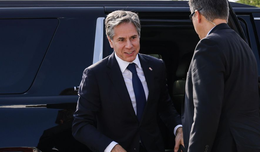 Secretary of State Antony Blinken, left, arrives to board a plane, Monday, July 26, 2021 at Andrews Air Force Base, Md., traveling to New Delhi, India and Kuwait City, Kuwait. (Jonathan Ernst/Pool via AP)