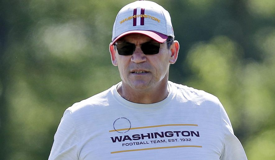 In this May 15, 2021, file photo, Washington Football Team head coach Ron Rivera watches during an NFL football rookie minicamp at Inova Sports Performance Center in Ashburn, Va. On the eve of the start of training camp, Rivera said Tuesday, July 27, 2021, that over half of his players are now fully vaccinated and expressed frustration about some of the reluctance. (AP Photo/Luis M. Alvarez, File)