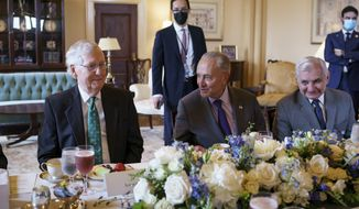 In this file photo, Senate Minority Leader Mitch McConnell, R-Ky., left, and Senate Majority Leader Chuck Schumer, D-N.Y., center, joined at right by Sen. Jack Reed, D-R.I., are seated together during a luncheon for Iraqi Prime Minister Mustafa Al-Kadhimi, at the Capitol in Washington, Wednesday, July 28, 2021. (AP Photo/J. Scott Applewhite)  **FILE**