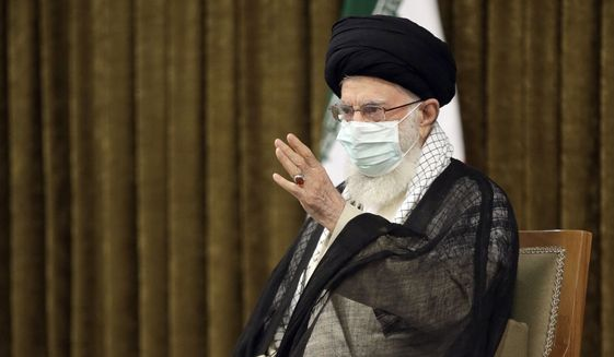 In this photo released by the official website of the office of the Iranian supreme leader, Supreme Leader Ayatollah Ali Khamenei speaks in a farewell meeting with outgoing President Hassan Rouhani's administration in Tehran, Iran, Wednesday, July 28, 2021. (Office of the Iranian Supreme Leader via AP)