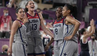 United States' Kelsey Plum, left, Stefanie Dolson (13), Jacquelyn Young (8) and Allisha Gray celebrate after defeating Russian Olympic Committee in a women's 3-on-3 gold medal basketball game at the 2020 Summer Olympics, Wednesday, July 28, 2021, in Tokyo, Japan. (AP Photo/Jeff Roberson)