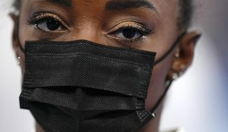 Simone Biles, of the United States, looks on after pulling out of the artistic gymnastics women's final at the 2020 Summer Olympics, Tuesday, July 27, 2021, in Tokyo. (AP Photo/Gregory Bull)