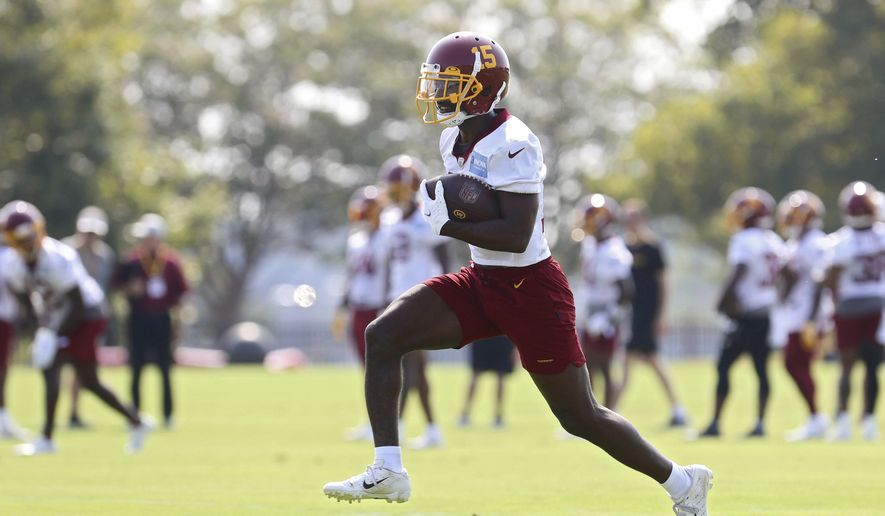 Washington Football Team wide receiver Steven Sims (15) catches a pass during NFL football practice in Richmond, Va., Wednesday, July 28, 2021. (AP Photo/Ryan M. Kelly) **FILE**