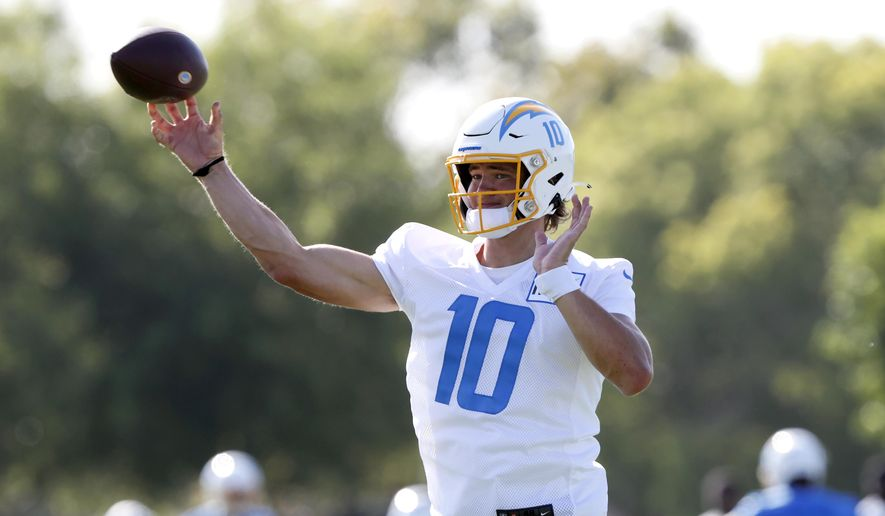 Los Angeles Chargers quarterback Justin Herbert throws a pass during practice at the NFL football team's training camp in Costa Mesa, Calif., Wednesday, July 28, 2021. (AP Photo/Alex Gallardo) **FILE**