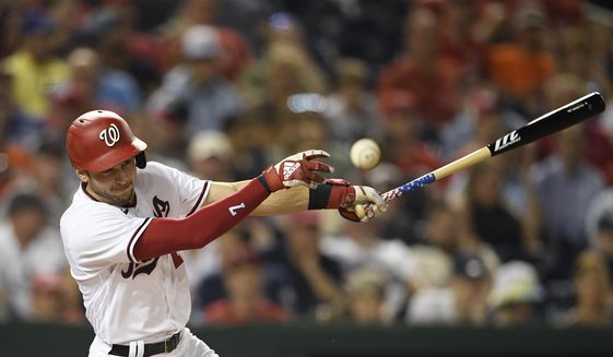 Washington Nationals' Trea Turner fouls off a pitch during the eighth inning of the team's baseball game against the Miami Marlins, Wednesday, July 21, 2021, in Washington. The Marlins won 3-1. (AP Photo/Nick Wass) **FILE**