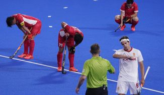 Japan players react after losing to Spain in a men's field hockey match at the 2020 Summer Olympics, Wednesday, July 28, 2021, in Tokyo, Japan. (AP Photo/John Locher)