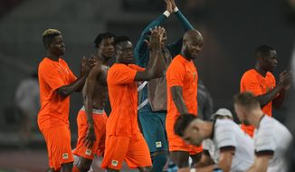 Ivory Coast players leave the pitch after a men's soccer match against Germany at the 2020 Summer Olympics, Wednesday, July 28, 2021, in Rifu, Japan. The match ended tied 1-1.(AP Photo/Andre Penner)