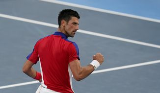 Novak Djokovic, of Serbia, reacts after defeating Alejandro Davidovich Fokina, of Spain, during the third round of the men's tennis competition at the 2020 Summer Olympics, Wednesday, July 28, 2021, in Tokyo, Japan. (AP Photo/Patrick Semansky)