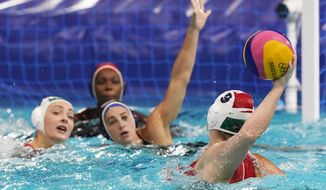 Hungary's Dora Leimeter (9) winds up to shoot during a preliminary round women's water polo match against the United States at the 2020 Summer Olympics, Wednesday, July 28, 2021, in Tokyo, Japan. (AP Photo/Mark Humphrey)