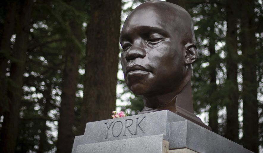 In this Sunday Feb. 21, 2021, file photo, the bust of York is seen on Mount Tabor in southeast Portland, Ore. Officials say the bust of York, commemorating an enslaved Black member of the Lewis and Clark Expedition was toppled and damaged. A Portland Parks and Recreation spokesperson told KOIN 6 News that the bust of York was torn from its pedestal and significantly damaged Tuesday night, July 27, or early Wednesday. (Mark Graves/The Oregonian via AP, File)