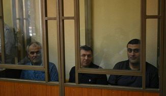 From left, Jehovah's Witnesses members Vilen Avanesov, Alkesandr Parkov, and Vilen's son Arsen Avanesov attend a hearing involving their case in Rostov-on-Don, Russia. On July 29, a court sentenced the men to terms ranging from six years to six and one-half years, following more than two years of pretrial detention. [Photo courtesy of Jehovah's Witnesses]