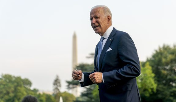 President Joe Biden speaks to members of the media before boarding Marine One on the South Lawn of the White House in Washington, Thursday, July 29, 2021, for a short trip to Walter Reed National Military Medical Center in Bethesda, Md., where he will join first lady Jill Biden who will undergo a procedure to remove an object from her left foot. (AP Photo/Andrew Harnik)
