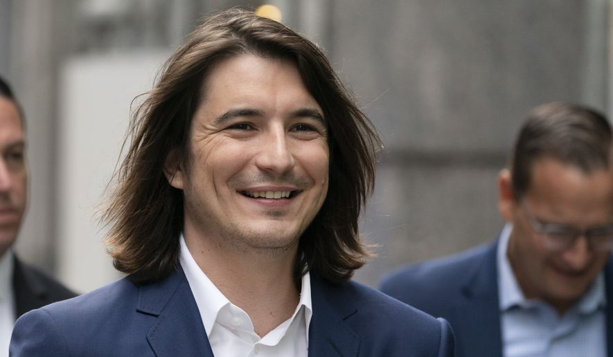 Vladimir Tenev, CEO and co-founder of Robinhood, walks in New York's Times Square following his company's IPO, Thursday, July 29, 2021. (AP Photo/Mark Lennihan)