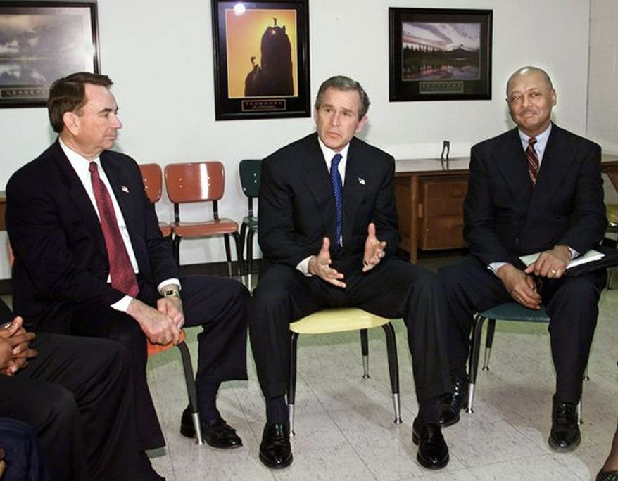 Health and Human Services Secretary Tommy Thompson and President George W. Bush meet in 2002 with Woodson Center president Robert Woodson (right) in Washington, D.C. (Photo courtesy the Woodson Center)