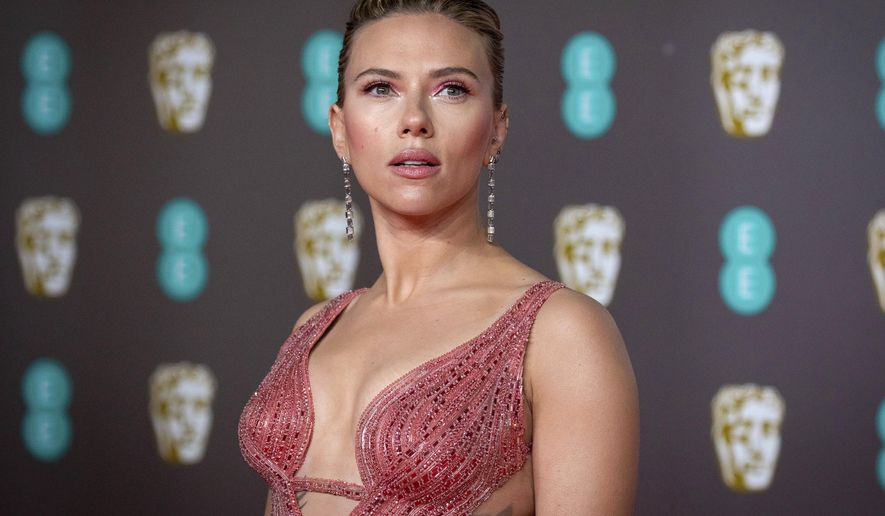 """Scarlett Johansson arrives at the Bafta Film Awards, in central London, Feb. 2, 2020. Johansson is suing the Walt Disney Co. over the company's streaming release of """"Black Widow,"""" which she said breached her contract and deprived her of potential earnings. The """"Black Widow"""" star and executive producer filed a suit Thursday, July 29, 2021, in the Los Angeles Superior Court that said her contract guaranteed an exclusive theatrical release. (Photo by Vianney Le Caer/Invision/AP, File)"""
