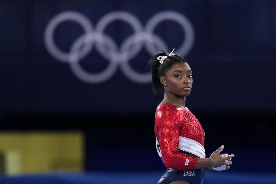 This July 27, 2021, file photo shows Simone Biles, of the United States, waiting to perform on the vault during the artistic gymnastics women's final at the 2020 Summer Olympics, Tuesday, July 27, 2021, in Tokyo. Biles' sponsors including Athleta and Visa are lauding her decision to put her mental health first and withdraw from the gymnastics team competition during the Olympics. It's the latest example of sponsors praising athletes who are increasingly open about mental health issues. (AP Photo/Gregory Bull, File)