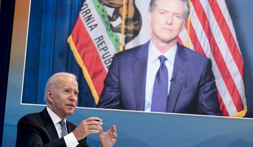 President Joe Biden speaks with California Gov. Gavin Newsom via teleconference during a meeting with governors to discuss ongoing efforts to strengthen wildfire prevention, preparedness and response efforts, and hear firsthand about the ongoing impacts of the 2021 wildfire season in the South Court Auditorium in the Eisenhower Executive Office Building on the White House Campus in Washington, Friday, July 30, 2021. (AP Photo/Andrew Harnik)