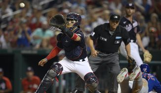 Chicago Cubs' Willson Contreras, right, slides home to score past Washington Nationals catcher Tres Barrera, left, on a single by Patrick Wisdom during the eighth inning of a baseball game, Friday, July 30, 2021, in Washington. (AP Photo/Nick Wass) **FILE**