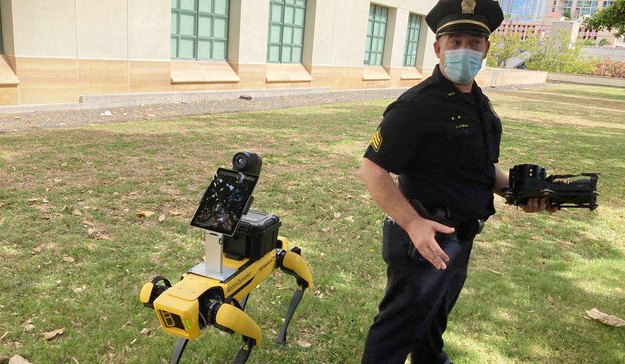 Honolulu Police Acting Lt. Joseph ONeal demonstrates a robotic dog in Honolulu, Friday, May 14, 2021. (AP Photo/Jennifer Sinco Kelleher) ** FILE **
