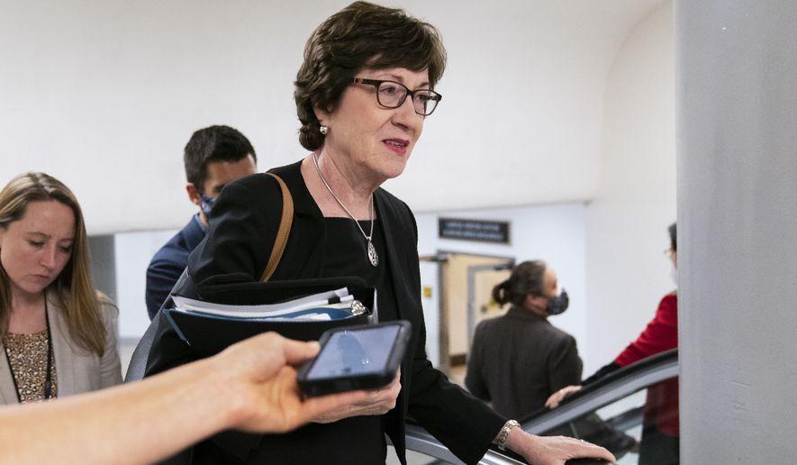 Sen. Susan Collins, R-Maine, takes an escalator from the Senate subway on Capitol Hill in Washington, Friday, July 30, 2021. (AP Photo/Manuel Balce Ceneta)