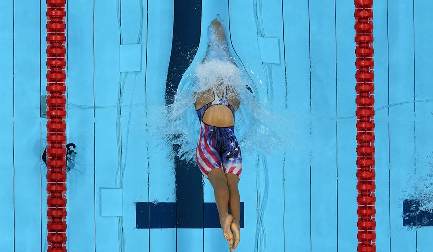Katie Ledecky, of the United States, starts the women's 800-meter freestyle final at the 2020 Summer Olympics, Saturday, July 31, 2021, in Tokyo, Japan. (AP Photo/Jeff Roberson)