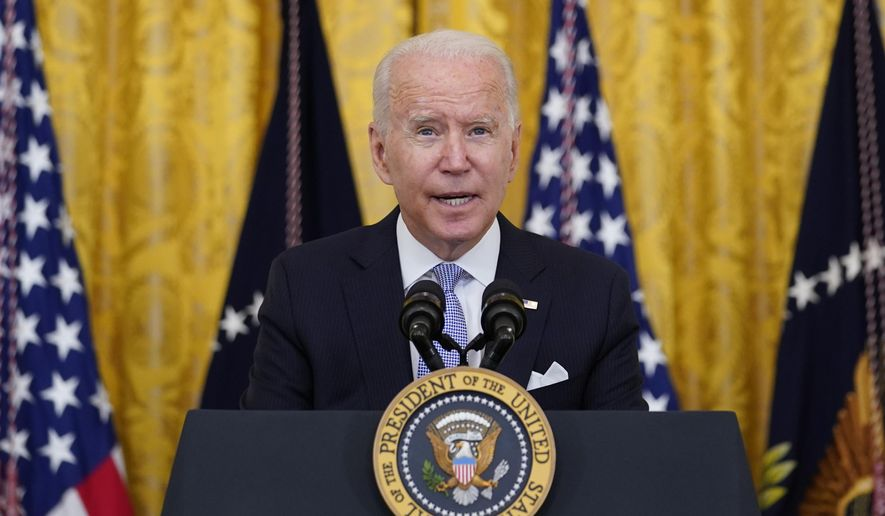 President Joe Biden announces from the East Room of the White House in Washington, Thursday, July 29, 2021, that millions of federal workers must show proof they've received a coronavirus vaccine or submit to regular testing and stringent social distancing, masking and travel restrictions in an order to combat the spread of the coronavirus. A new poll from The Associated Press-NORC Center for Public Affairs Research finds 6 in 10 Democrats say they're optimistic about their party's future. And Democrats nearly universally approve of the way President Joe Biden is handling his job. (AP Photo/Susan Walsh)
