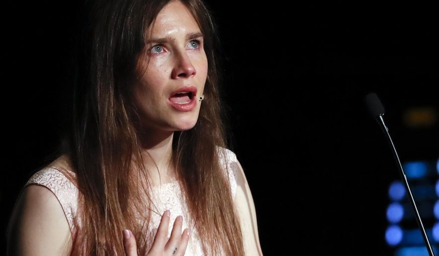 """FILE - In this June 15, 2019 file photo, Amanda Knox gets emotional as she speaks at a Criminal Justice Festival at the University of Modena, Italy.   Knox is speaking out about her name being associated with the new film """"Stillwater,"""" Friday, July 30, 2021, saying any connection rips off """"my story without my consent at the expense of my reputation."""" """"Stillwater"""" stars Matt Damon as a father who flies to France to help his estranged daughter, who has been convicted of murdering her girlfriend.  (AP Photo/Antonio Calanni, File)"""