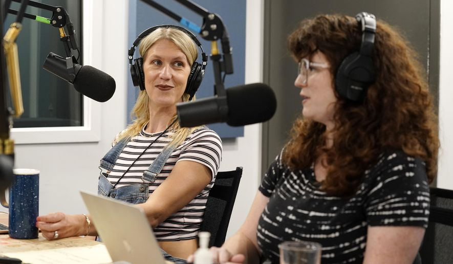"""Tess Barker, left, and Barbara Gray, co-hosts of the """"Britney's Gram"""" podcast, talk in the studio at Earwolf podcast studio, Thursday, July 15, 2021, in Los Angeles. (AP Photo/Chris Pizzello)"""