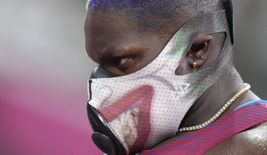 Raven Saunders, of United States, waits to compete in the qualification rounds of the women's shot put at the 2020 Summer Olympics, Friday, July 30, 2021, in Tokyo. (AP Photo/Matthias Schrader)