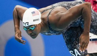 Simone Manuel, of United States, swims in a women's 50-meter freestyle heat at the 2020 Summer Olympics, Friday, July 30, 2021, in Tokyo, Japan. (AP Photo/Gregory Bull)